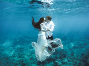 bride and groom underwater wedding photo